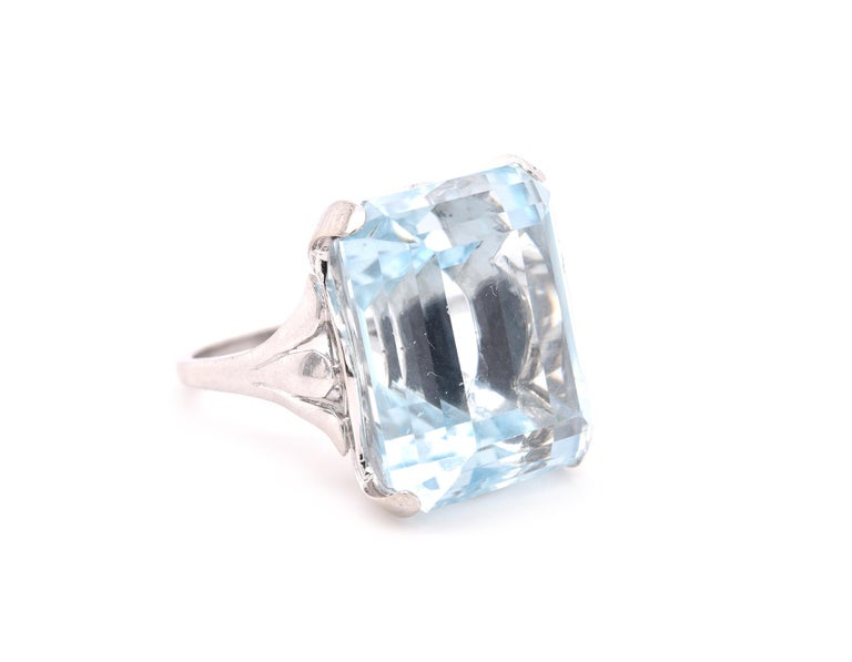 Designer: custom Material: platinum Blue Topaz: 1 emerald cut = 35.40ct Ring Size: 6.5 (please allow up to 2 additional business days for sizing requests) Dimensions: ring top measures 19.5mm X 16mm Weight:  17.79 grams