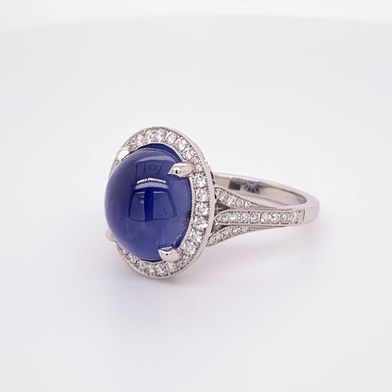 A stunning and elegant Natural Unheated Blue Star Sapphire GIA certified. The piece is platinum weighs 9.5 grams and the size is 5.75.  Set with 70 natural round brilliant diamonds weighing 0.45cts.
