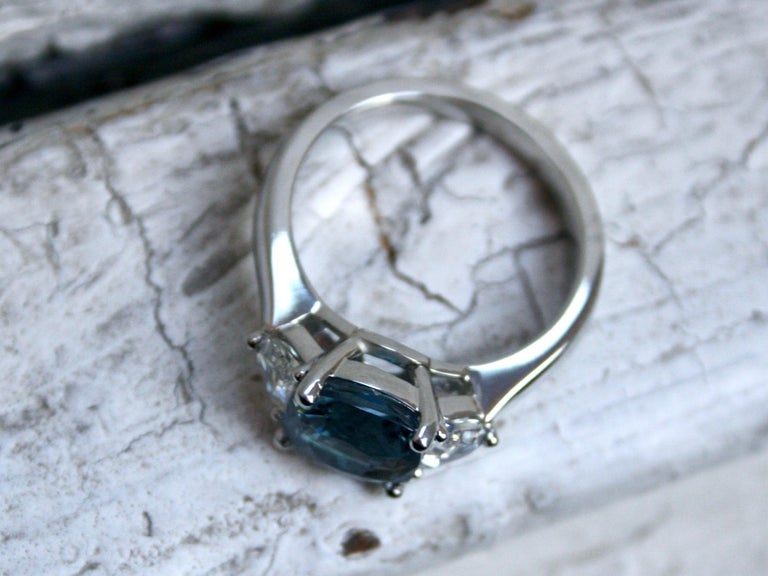 Cushion Cut Platinum Ceylon Sapphire Three-Stone Ring with Shield Cut Diamonds 3.69 Carat For Sale