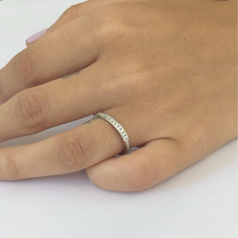 Platinum channel set 2.5 millimeter diamond wedding band or stacking ring Diamond weight 0.60 Diamond quality G VS Our team of graduate gemologists carefully hand-select every diamond and sapphire .  Ring size 6  Ring cannot be sized