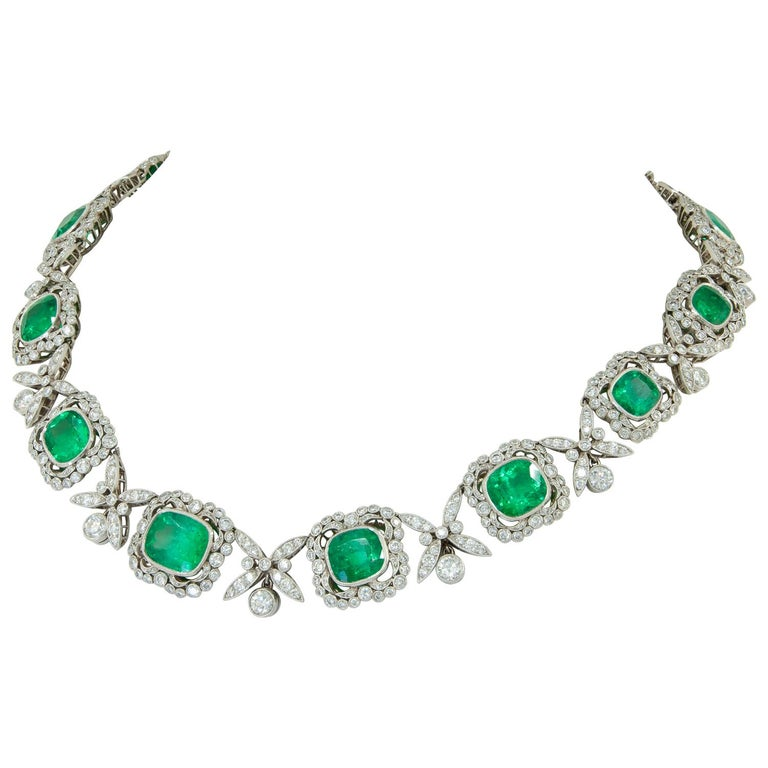 Platinum Colombian Emerald, Diamond Necklace. A platinum necklace, set with diamonds and cushion and square Colombian Emerald with AGL certificate. Dimensions approx. 16 inches Gross weight approx. 81.8 grams Circa 1950s Condition: Good - Previously