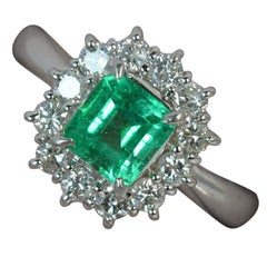 Platinum Columbian Emerald and 0.50 Carat VS Diamond Cluster Engagement Ring