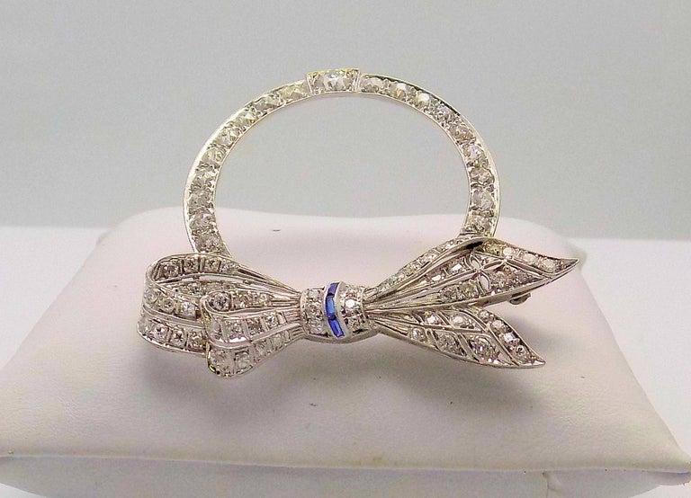 Old European Cut Platinum Diamond and Sapphire Art Deco Circle Bow Brooch For Sale