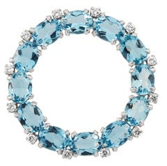 Platinum, Diamond and Blue Topaz Circle Brooch