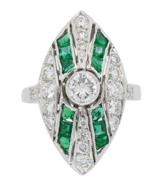 Platinum Diamond and Emerald Navette Style Ring