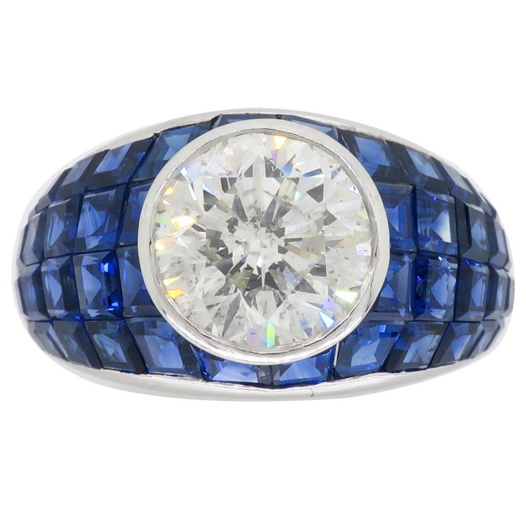 Platinum Diamond and Invisible Set Blue Sapphire Ring For Sale