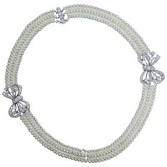 Platinum, Diamond and Natural Oriental Pearl Necklace