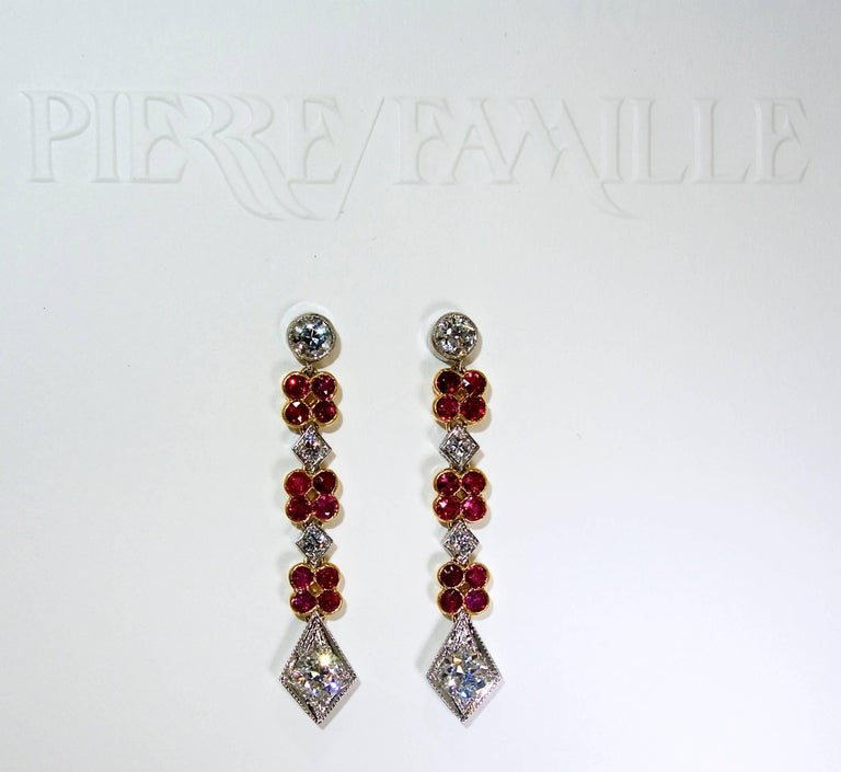 Burma rubles (24 natural bright red stones) are set in 18K yellow gold within the platinum earrings.  These natural rubies weigh approximately .70 cts.  The total diamond weight is approximately 1.85 cts. The older cut diamonds are all near