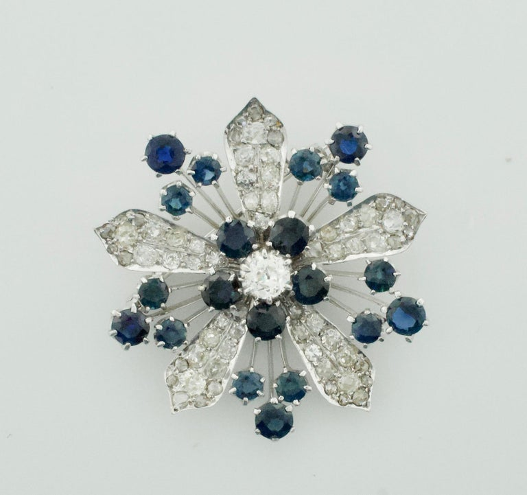 Platinum Diamond and Sapphire Brooch - Necklace Circa 1920's 6.85 carats. One Old European Cut Diamond weighing .65 carats approximately [GHI - SI]  [bright with no imperfections visible to the naked eye] Thirty Five Round Cut Diamonds weighing 5.50