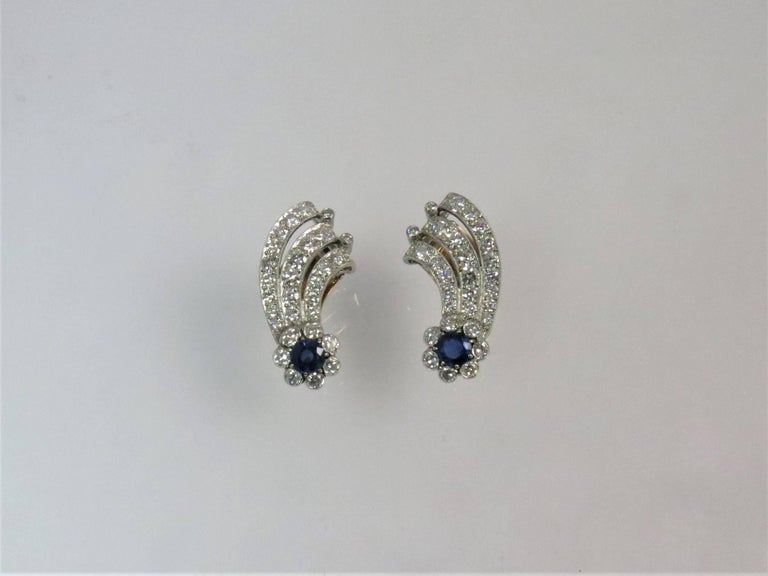 Contemporary Platinum Diamond and Sapphire Ear Clips For Sale