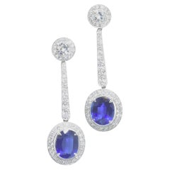 Platinum, Diamond and Sapphire Earrings by Pierre/Famille, Inc.
