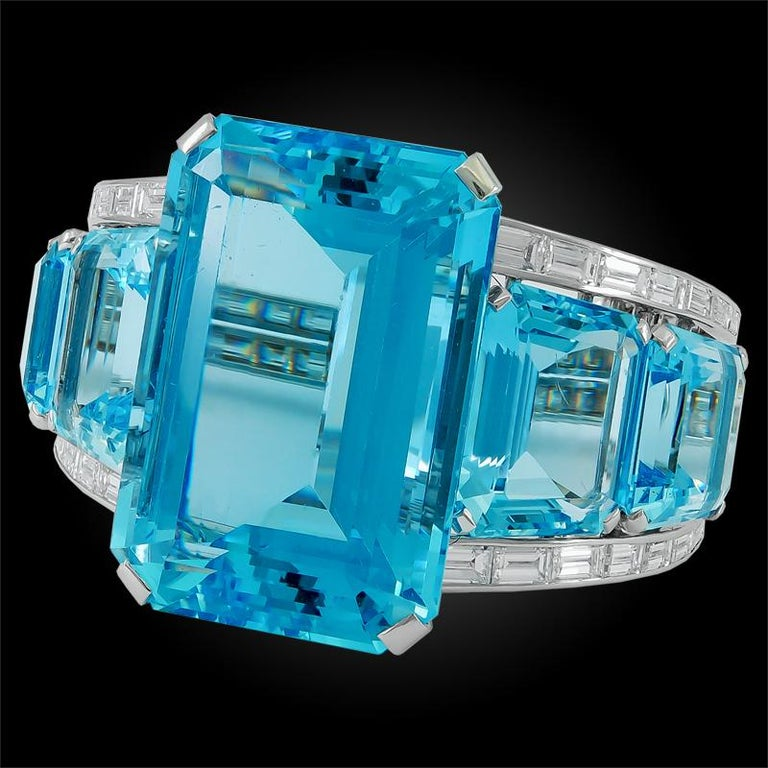 A majestic bangle crafted in the 1950s, designed as a band of brilliant aquamarines and diamonds, centering one large emerald cut aquamarine stone weighing approximately 182 carats, mounted in platinum.