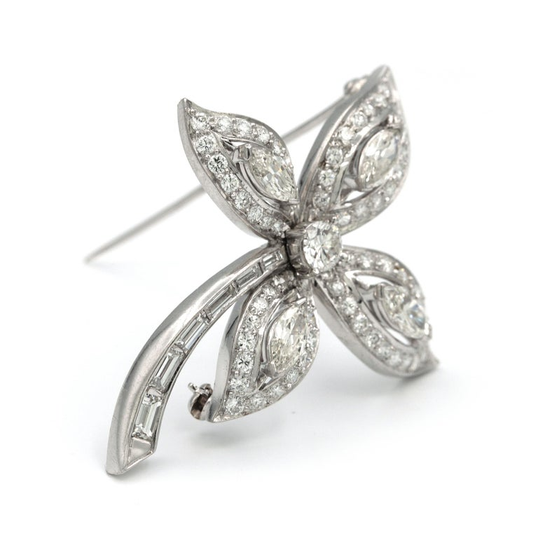 Platinum Flower shaped brooch, with center round diamond Set with 4.41 carats of white diamonds, including 4 marquise shaped stones, 1 round shape, 6 rectangular cut stones, along with 61 pave stones. Has a length of 4.3cm and a width of 4cm Weights