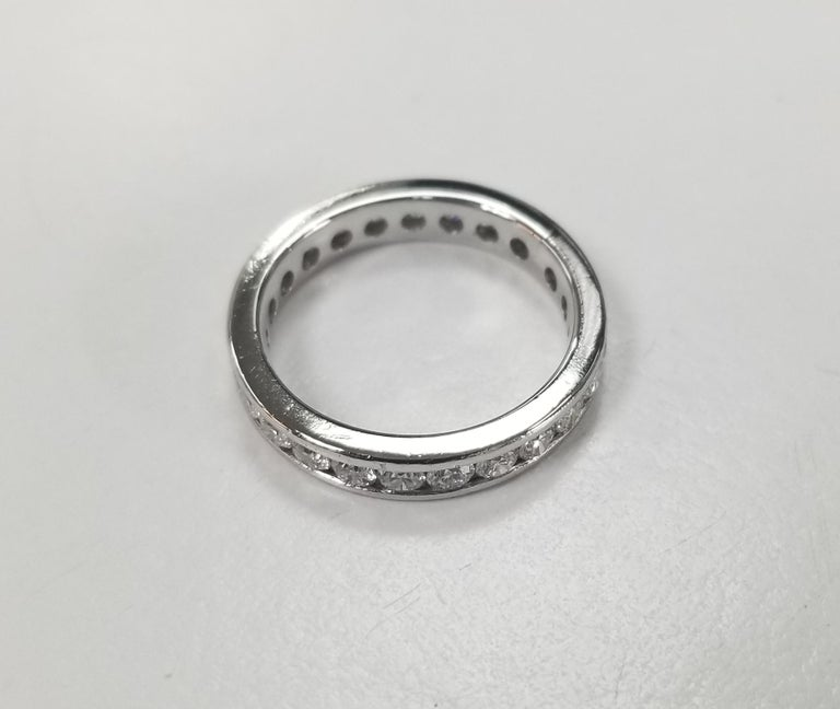 Contemporary Platinum Diamond Channel Set Eternity Ring For Sale