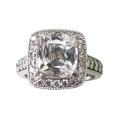 Platinum Diamond Halo with a Kunzite Cushion Cut Stone