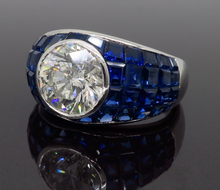 Round Cut Platinum Diamond and Invisible Set Blue Sapphire Ring For Sale
