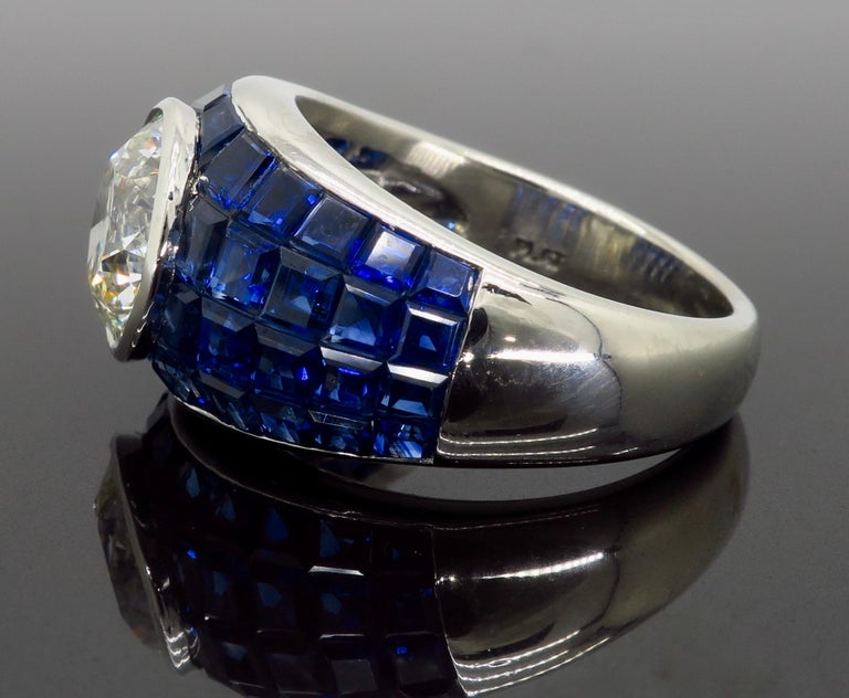 Platinum Diamond and Invisible Set Blue Sapphire Ring In Excellent Condition For Sale In Webster, NY