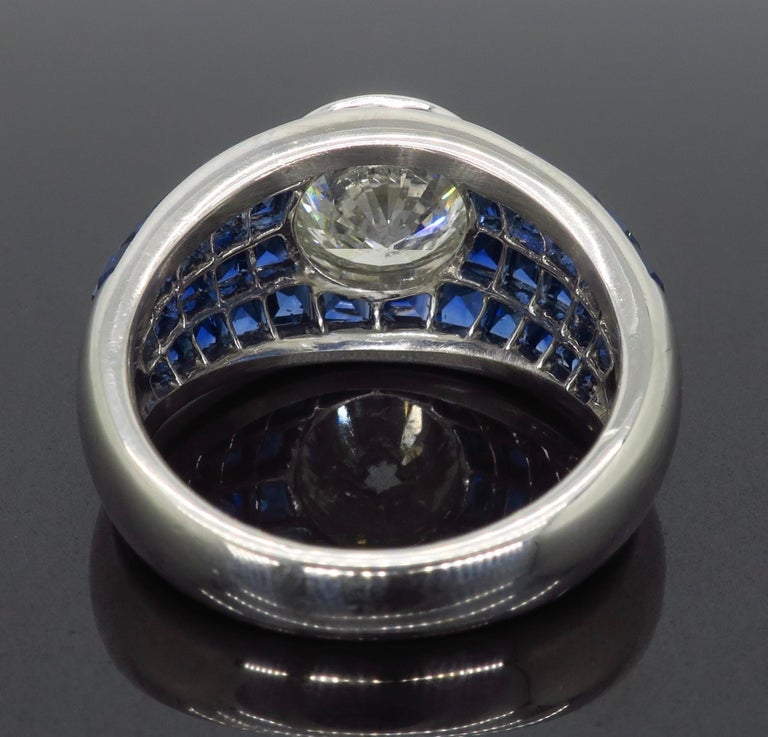 Women's or Men's Platinum Diamond and Invisible Set Blue Sapphire Ring For Sale