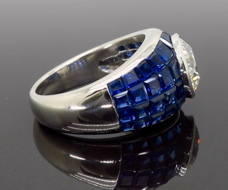 Platinum Diamond and Invisible Set Blue Sapphire Ring For Sale 1