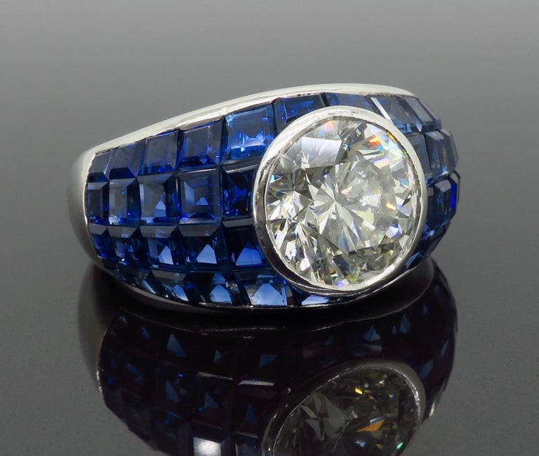 Platinum Diamond and Invisible Set Blue Sapphire Ring For Sale 2
