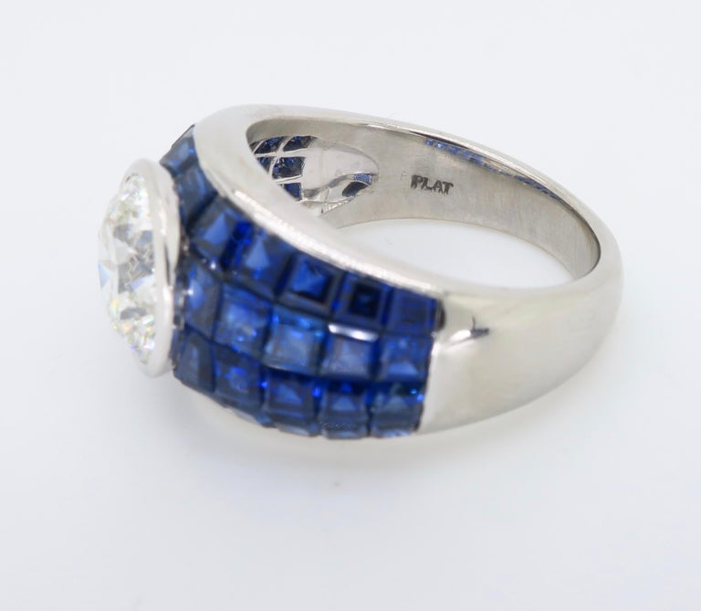 Platinum Diamond and Invisible Set Blue Sapphire Ring For Sale 3