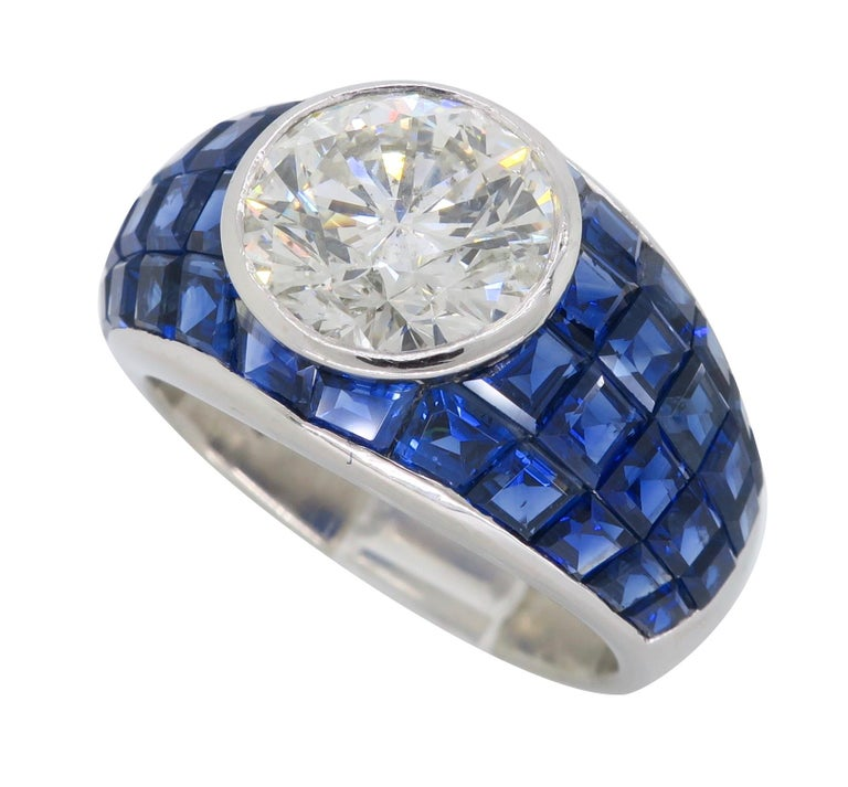Platinum Diamond and Invisible Set Blue Sapphire Ring For Sale 4