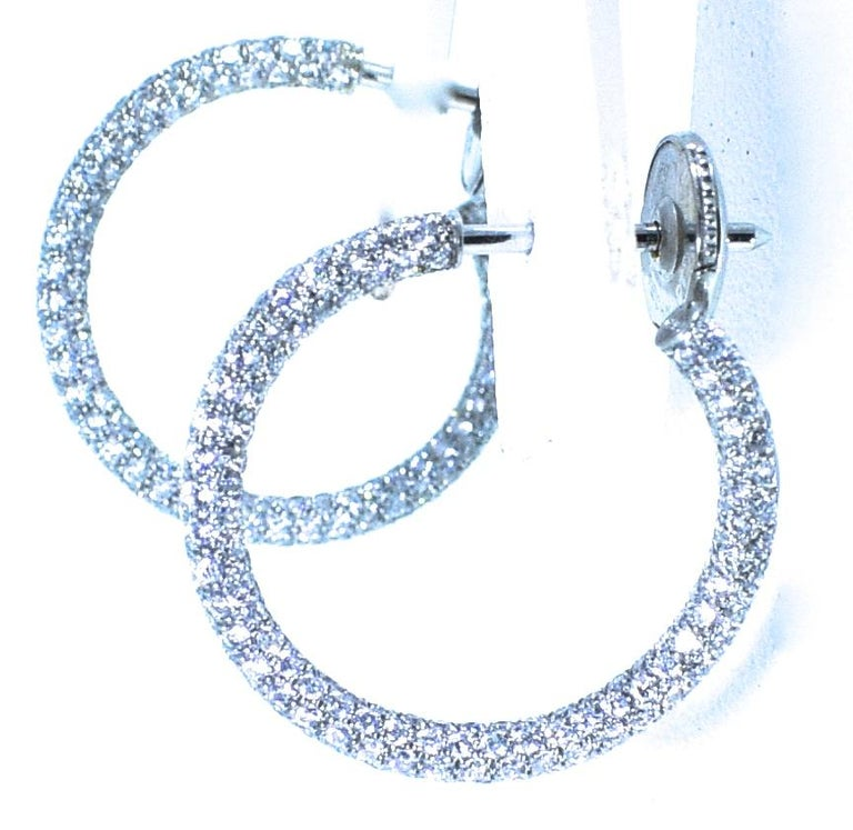 Platinum diamond small hoops with 350 brilliant cut diamonds equalling approximately 1.4 cts.  These hoops are completely paved with diamonds - both inside and outside.  The diamonds are  are all well pave set, near colorless, H, and very slightly