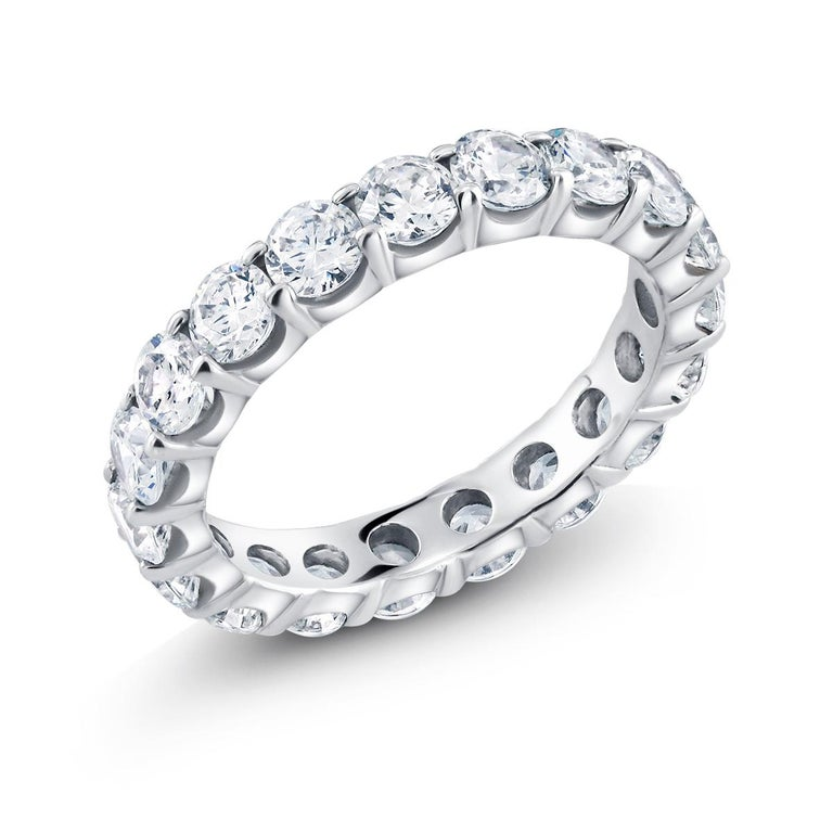 Contemporary Platinum Diamond Prong Set Eternity Ring Weighing 3.00 Carat For Sale