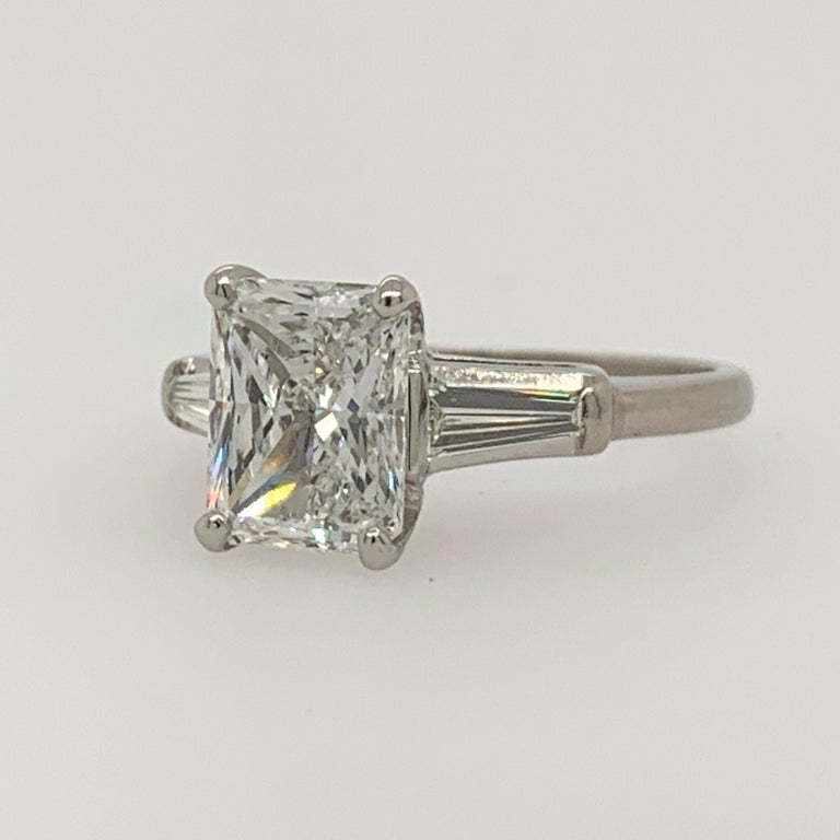 Platinum Ring Radiant cut 2ct total weight. The centerstone is 1.80 carats , D in color and SI2 in clarity by EGL USA. Measuring an impressive 8.43x6.67x3.89mm, it looks like a larger stone.   The tapered baguette sidestones are approximately 0.20