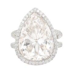 Platinum Diamond Ring with Pear Shape Diamond Center