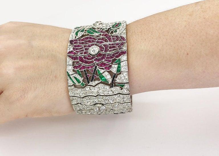 Mixed Cut Diamond Ruby Emerald Onyx Platinum Flower Bracelet For Sale