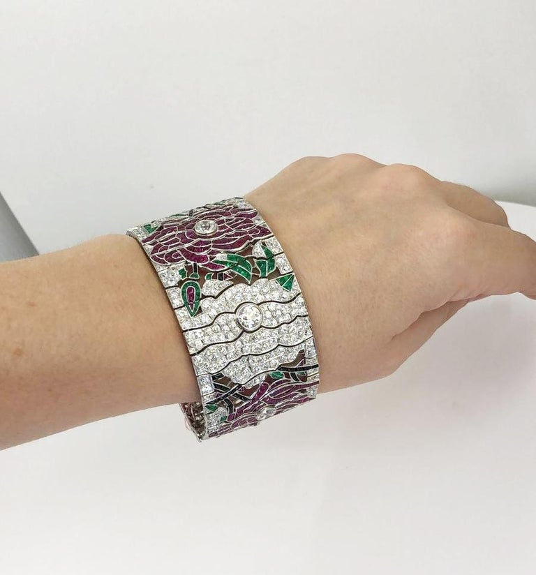 Diamond Ruby Emerald Onyx Platinum Flower Bracelet In Good Condition For Sale In New York, NY