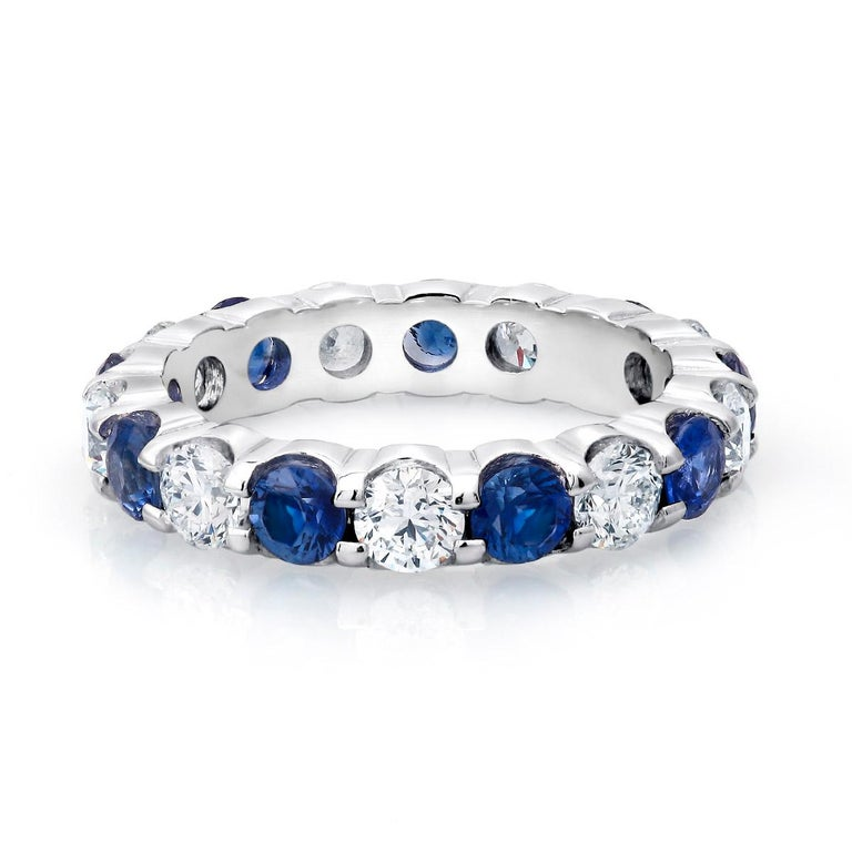 Contemporary Platinum Diamond Sapphire Prong Set Eternity Ring Weighing Four Carats For Sale