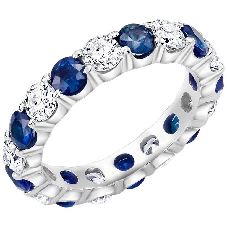 Platinum Diamond Sapphire Prong Set Eternity Ring Weighing Four Carats For Sale