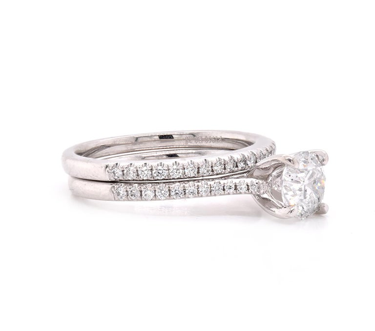 Material: platinum Center Diamond: 1 round brilliant cut = 1.02ct Color: G Clarity: I1 Diamonds: 43 round cut = .65cttw Color: G Clarity: VS Ring Size: 7 (please allow up to 2 additional business days for sizing requests) Dimensions: ring shank