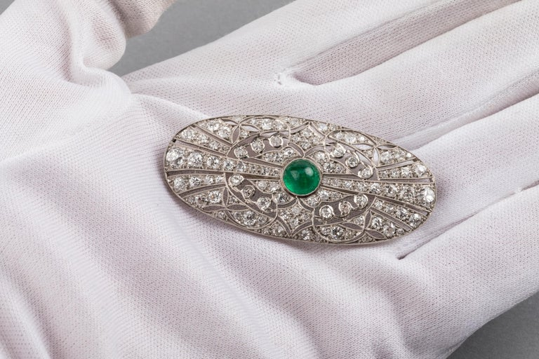 Platinum Emerald and 3.50 Carat Diamonds French Art Deco Brooch  Very beautiful brooch, made in France circa 1930.  Made with platinum, one emerald of 1.30 carats and 3.50 carats of diamonds.  The emerald and the diamonds are good quality.