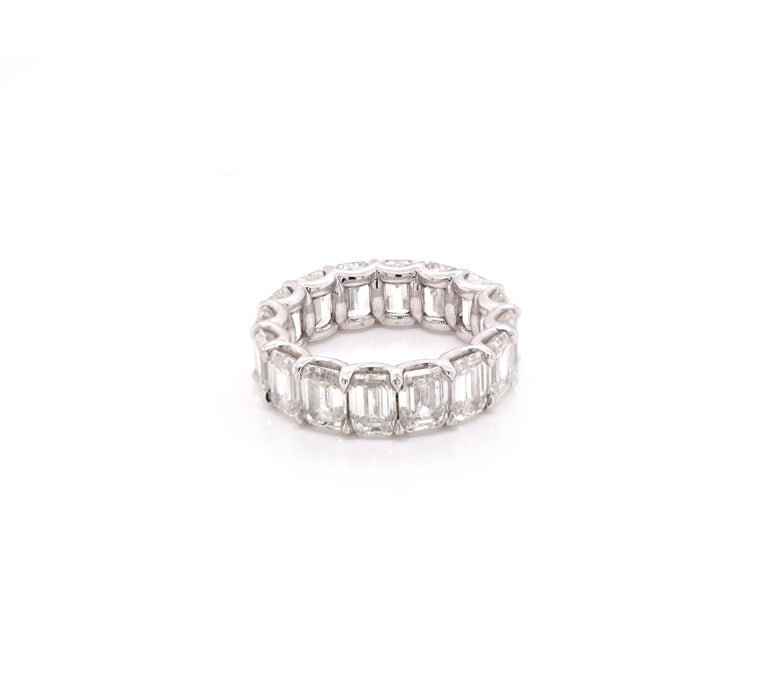 Designer: Custom Material: platinum Diamonds: 16 emerald cut =8.48cttw Color: G - H Clarity: (2) IF, (2) VVS1, (2) VVS2, (2) VS1, (8) VS2 GIA CERTS INCLUDED Size: 5.5 Dimensions: ring measures 5.82mm in width Weight: 6.49 grams