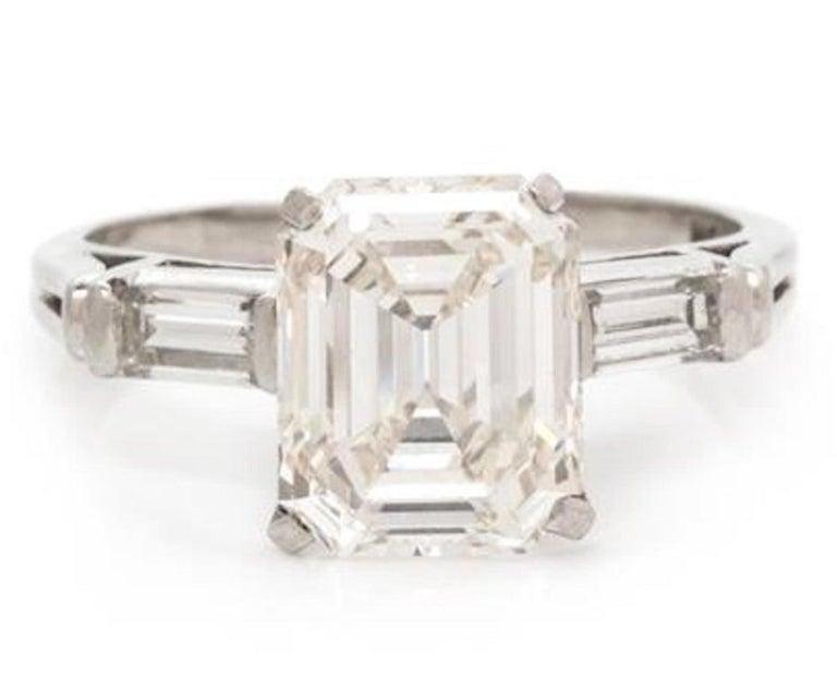 Modern Platinum Emerald Cut Diamond Ring 2.84 Carat For Sale