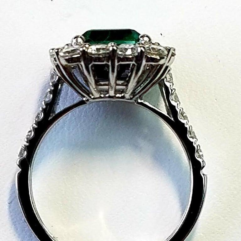 Contemporary Platinum Emerald Cut Emerald and Diamond Ring For Sale