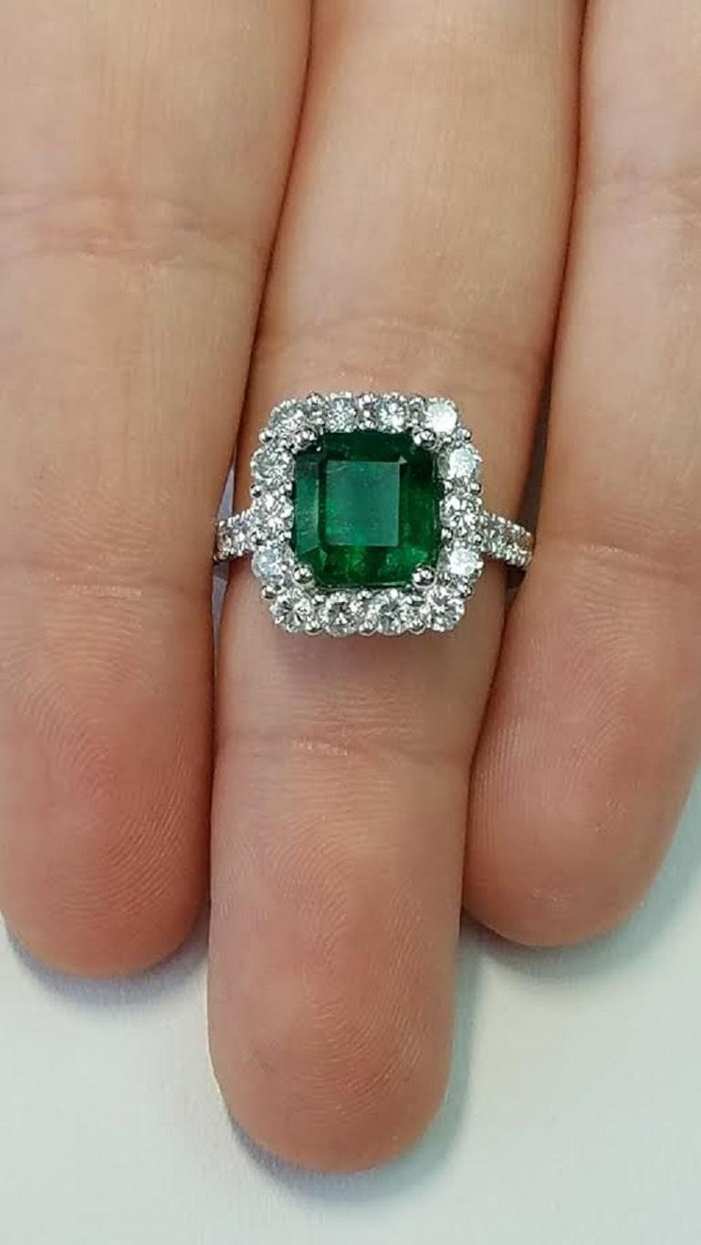 Platinum Emerald Cut Emerald and Diamond Ring In New Condition For Sale In Great Neck, NY