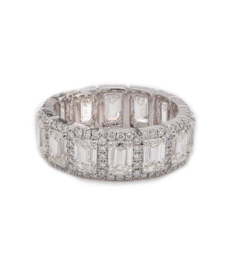 Designer: Custom Material: platinum Diamonds: 14 emerald cut = 4.31cttw Color: G Clarity: VS2 Diamonds: 154 round cut = .65cttw Color: G Clarity: VS Size: 6.5 Dimensions: ring measures 7mm in width Weight: 7.74 grams