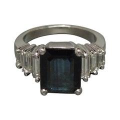 Platinum 4 carat Emerald Cut Sapphire Ring