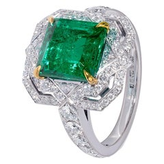 Platinum Emerald Ring with White Diamond Halo in Art Deco Style