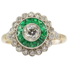 Platinum Emeralds and Diamonds Ring