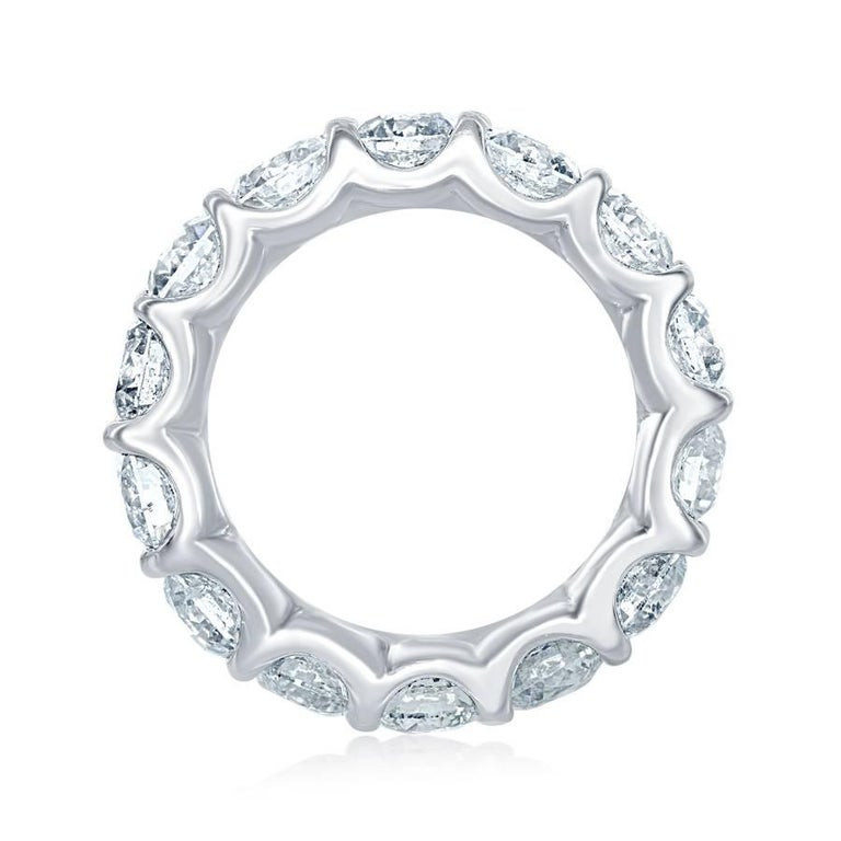 This Low setting eternity band is absolutely a magnificent piece. Total weight is 6.76 carats. The ring consists of 13 stones each weighing approximately 0.50 carats. The color is G-H and the clarity is SI-SI2. This eternity is set in platinum. Ring