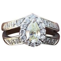 Platinum Fancy Yellow Diamond and White Diamond Pear Shape Ring 0.90 Carat 6.9g