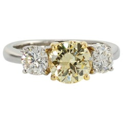 Platinum Fancy Yellow Three-Stone Round Diamond Engagement Ring