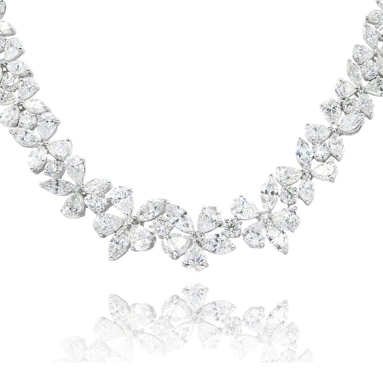 Platinum flower diamond necklace features 52.20 ct of round, marquise and pear shape diamonds