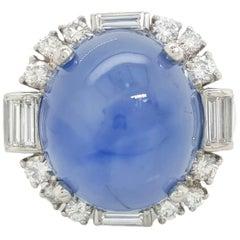 Platinum GIA 27.2 Carat Blue Star Sapphire and Diamond Halo Cocktail Ring
