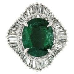 Platinum GIA 5.59 Carat Oval Emerald and Baguette Diamond Wave Ballerina Ring
